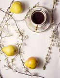 Pears with coffee cup Royalty Free Stock Images