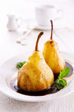 Pears Cooked in chocolate sauce Royalty Free Stock Photo