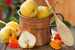 Pears in copper jug Stock Photo