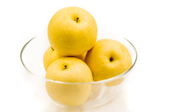 Pears in a crystal bowl. Isolated on white background Royalty Free Stock Photos