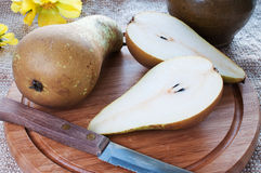 Pears on cutting board Stock Images