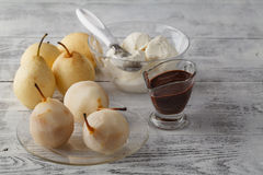 Pears in dark chocolate, sweet dessert set with modern copper co Royalty Free Stock Image