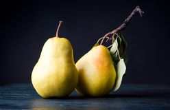 Pears on dark wooden background Royalty Free Stock Images