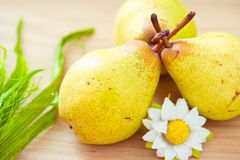 Pears on dinner table with daisy Stock Images
