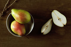 Pears with drops on a wooden background.  Royalty Free Stock Photography