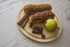 Pears and eclairs Stock Photography