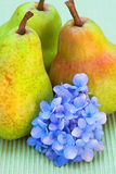 Pears and flower Stock Photos