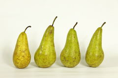 Pears. Four green pears on a white background Royalty Free Stock Photography