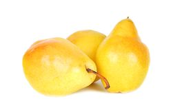 Pears fresh. Some yellow sweet pears and isolated over white background. Nice fall fruits royalty free stock photography