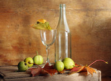 Pears and glass Royalty Free Stock Images