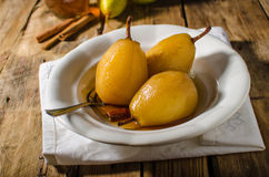 Pears glazed in tea and cinnamon Stock Images