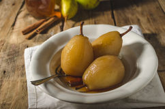 Pears glazed in tea and cinnamon Royalty Free Stock Photography