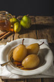 Pears glazed in tea and cinnamon Royalty Free Stock Images