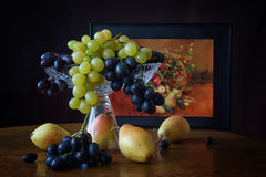 Pears and grapes. Still life with pears and grapes stock images