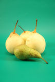 Pears on a green background. Stock Photos
