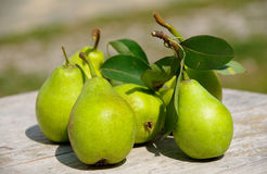 Pears. Green pears on a wooden table royalty free stock images