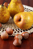 Pears and hazelnuts Royalty Free Stock Photos