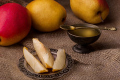 Pears and honey Stock Photography