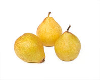 Pears isolated. Three delicious yellow pears isolated Royalty Free Stock Photography