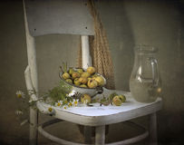 Pears and jug with water Royalty Free Stock Photography