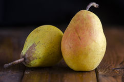 Pears. 2 juicy pears on a wooden board Royalty Free Stock Photography