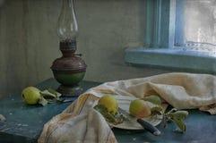 Pears and kerosene lamp Stock Image