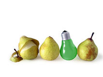 Pears and Lamp. Three pears and green pear-shape lamp bulb isolated in white background Stock Image