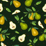 Pears with leaves on dark green backgrond Stock Photo