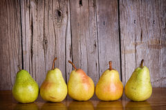 Pears lined up in a row Royalty Free Stock Images