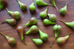 Pears lying on the wooden table Stock Photos