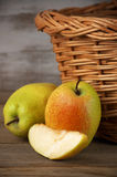 Pears near basket Stock Photo