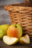 Pears near basket Stock Photography