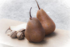 Pears and nuts Royalty Free Stock Image
