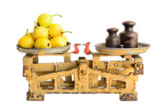 Pears on old scales Royalty Free Stock Photos