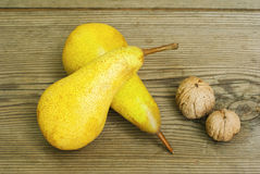 Pears on old wooden table Stock Photography