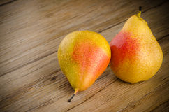 Pears in a old wooden table Royalty Free Stock Image