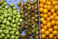 Pears and oranges at the market Royalty Free Stock Photo