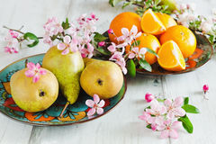 Pears and oranges Stock Photo