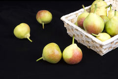 Pears. In and out of the basket Stock Images