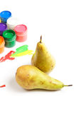 Pears and paints Stock Images