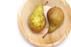 Pears on palm leaf plate Stock Image