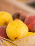 Pears and peaches in bowl Stock Photography