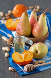Pears and persimmons Stock Image