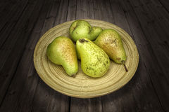 Pears on a plate Stock Images