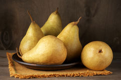 Pears in plate Stock Images