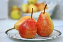 Pears on a plate Stock Photos