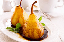 Pears Poached in Amaretto with Chocolate Sauce Stock Photography