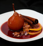 Pears poached in red wine Stock Photo
