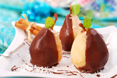 Pears poured with chocolate Stock Images