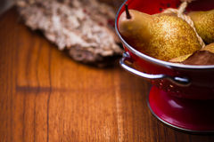 Pears on red colander Royalty Free Stock Image
